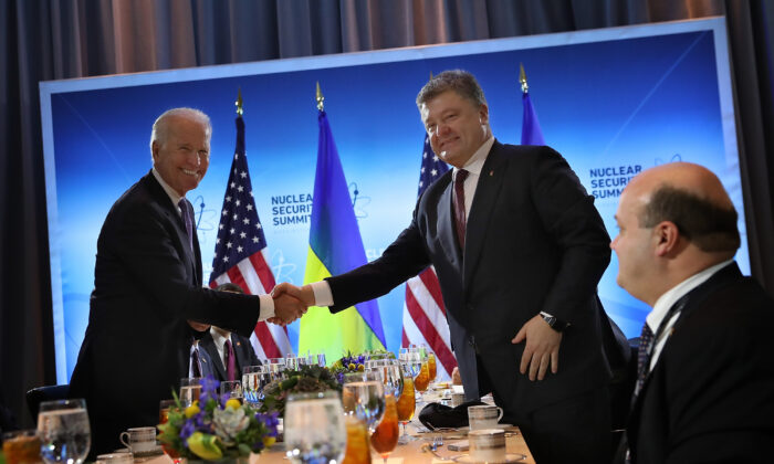 Then-Vice President Joe Biden (L) shakes hands with then-Ukrainian President Petro Poroshenko (R) before their meeting in Washington on March 31, 2016. (Win McNamee/Getty Images)
