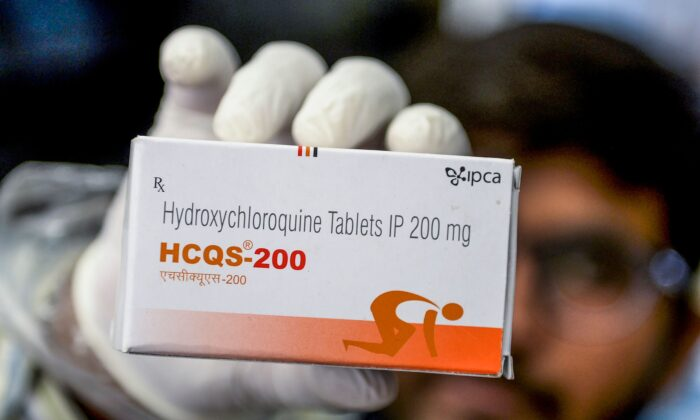 A pharmacist displaying a box of hydroxychloroquine (HCQ) tablets in his store in Hyderabad, India, on April 28, 2020. (Noah Seelam/AFP via Getty Images)