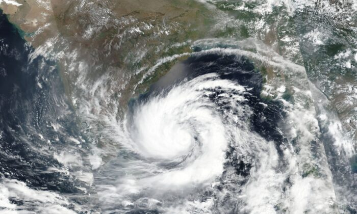 This May 17, 2020, satellite image released by NASA shows Cyclone Amphan over the Bay of Bengal in India. (NASA Worldview, Earth Observing System Data and Information System (EOSDIS) via AP)