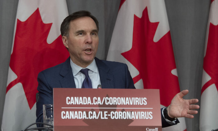 Finance Minister Bill Morneau responds to a question during a news conference in Ottawa on March 27, 2020. (The Canadian Press/Adrian Wyld)
