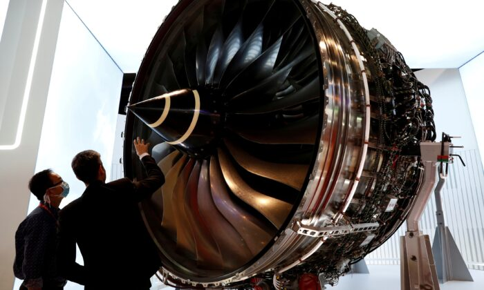 A man looks at Rolls Royce's Trent Engine displayed at the Singapore Air show in Singapore, on Feb. 11, 2020. (Edgar Su/Reuters)