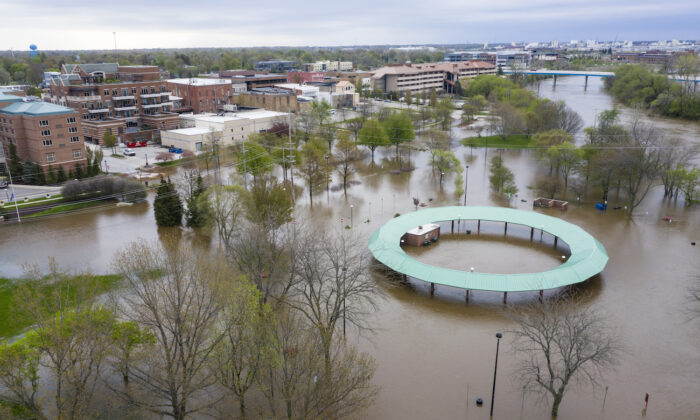 Water floods the Midland Area Farmers Market and the tridge along the Tittabawassee River in Midland on May 19, 2020. (Kaytie Boomer/MLive.com via AP)