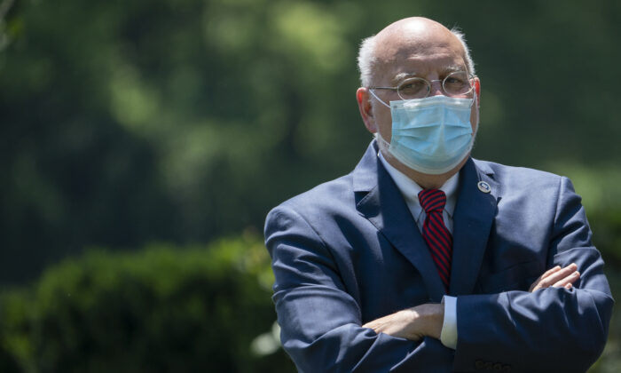Dr. Robert Redfield, director of the Centers for Disease Control and Prevention, attends an event about CCP virus vaccine development in the Rose Garden of the White House in Washington on May 15, 2020. (Drew Angerer/Getty Images)