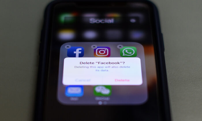 This photo illustration taken on March 27, 2018, shows apps for Facebook, Instagram, Twitter and other social networks on a smartphone in the Indian capital New Delhi. (Chandan Khanna/AFP via Getty Images)