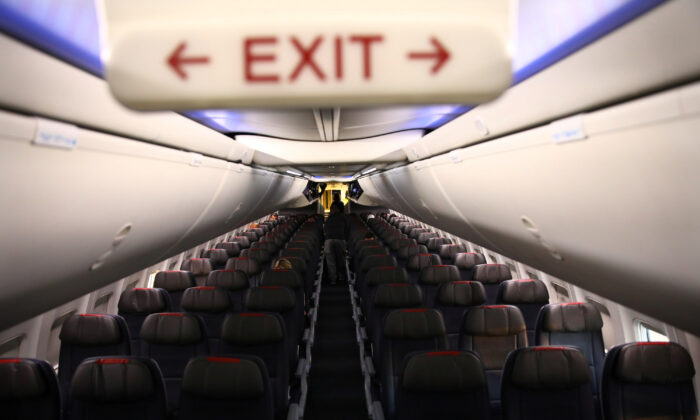 Rows of empty seats of an American Airlines flight in Washington, on March 18, 2020. (REUTERS/Carlos Barria)