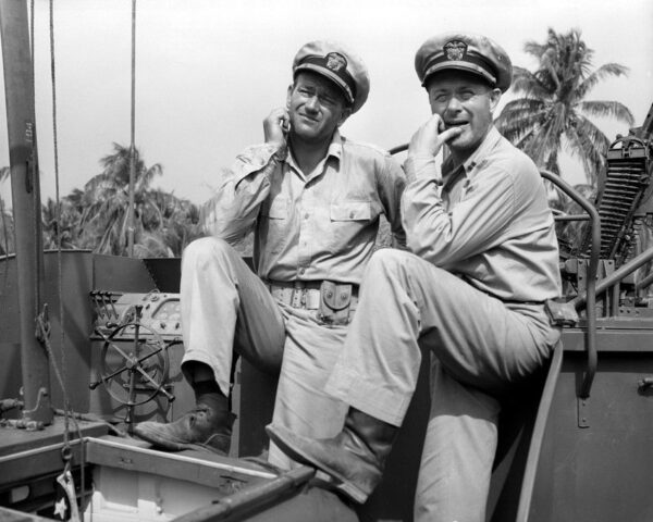 John Wayne and Robert Montgomery in They Were Expendable