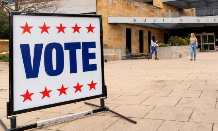Voters enter and exit the Austin City Hall during the presidential primary in Austin, Texas, on Super Tuesday on March 3, 2020. (Suzanne Cordeiro/AFP via Getty Images)