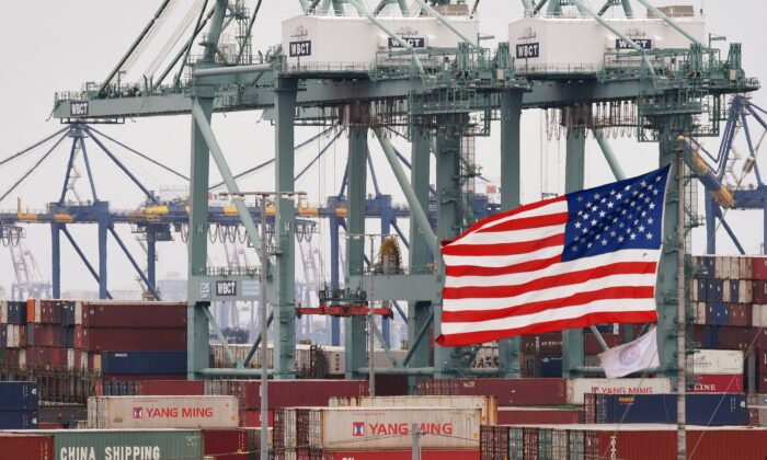 Chinese shipping containers are stored beside a US flag after they were unloaded at the Port of Los Angeles in Long Beach, Calif., on May 14, 2019. (MARK RALSTON/AFP via Getty Images)