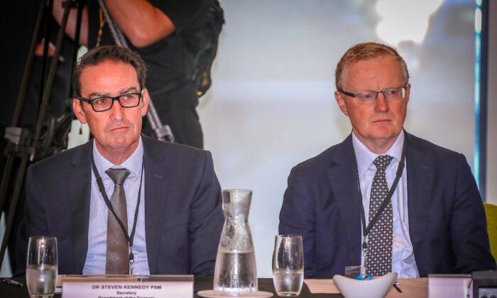 Philip Lowe, Governor of the Reserve Bank of Australia, sits next to Steven Kennedy (left), Secretary to the Department of Treasury, during the Meeting of the Council of Australian Governments (COAG) at Parramatta Stadium in western Sydney on March 13, 2020. (David Gray/Getty Images)