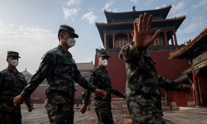 China's People's Liberation Army soldiers march next to the entrance to the Forbidden City during the opening ceremony a political meeting in Beijing on May 21, 2020. (NICOLAS ASFOURI/AFP via Getty Images)