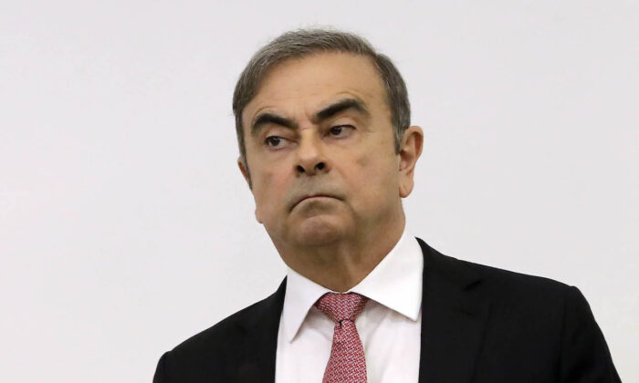 Former Renault-Nissan boss Carlos Ghosn looks on before addressing a large crowd of journalists on his reasons for dodging trial in Japan, where he is accused of financial misconduct, at the Lebanese Press Syndicate in Beirut on Jan. 8, 2020. (Joseph Eid/AFP via Getty Images)