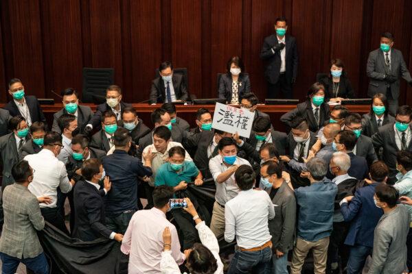 Lawmakers Scuffle In Hong Kong Amid The Coronavirus Pandemic