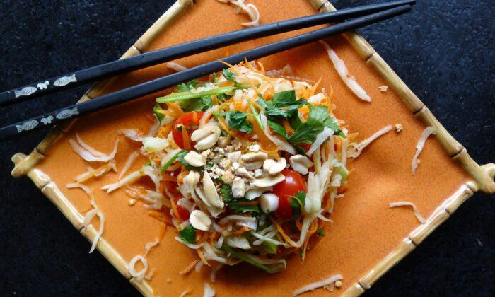 """Kohl som, loosely translated to """"Thai-style sour kohlrabi,"""" swaps som tom's shredded green papaya for kohlrabi. (Ari LeVaux)"""