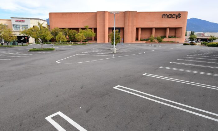 An empty parking lot in front of Macy's is seen at the Westfield Santa Anita shopping mall in Arcadia, Calif., on March 18, 2020. (Frederic J. Brown/AFP/Getty Images)