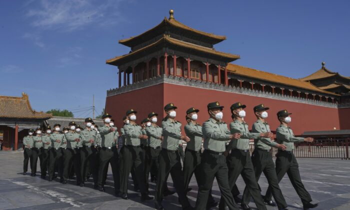 The paramilitary police officers march outside the Forbidden City, near Tiananmen Square in Beijing, on May 20, 2020. (Kevin Frayer/Getty Images)