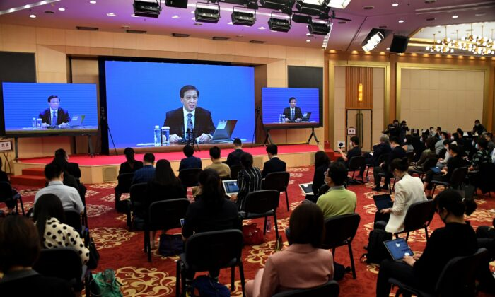 Zhang Yesui, the spokesperson for the third session of the 13th National People's Congress, speaks during a video online press conference in Beijing a day before the opening ceremony of the NPC, on May 21, 2020. Zhang said the NPC will discuss a proposal for a national security law in Hong Kong at its annual session. (Leo Ramirez/AFP via Getty Images)