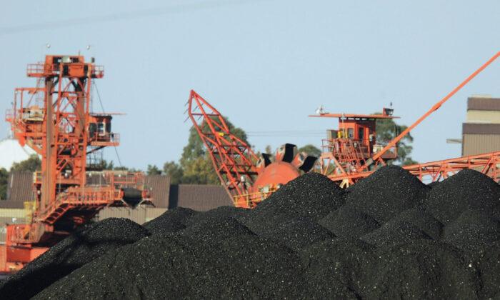 Large coal stocks await loading for export at Port Waratah Coal Services on Newcastle, Australia, on April 12, 2007. (Corey Davis/Getty Images)