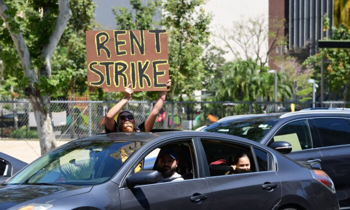 Demonstrators call for a rent strike during the CCP virus pandemic as they pass City Hall in Los Angeles on May 1, 2020. (Frederic J. Brown/AFP via Getty Images)