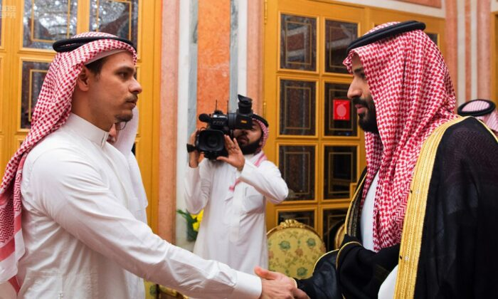 Salah Khashoggi, (L), a son of Jamal Khashoggi, shakes hands with Saudi Crown Prince Mohammed bin Salman in Riyadh, Saudi Arabia on Oct. 23, 2018. (Saudi Press Agency via AP)