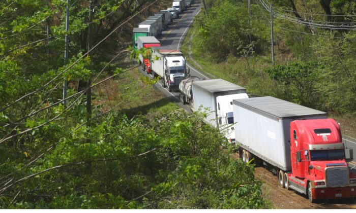 Trucks are parked in a queue at the border between Costa Rica and Nicaragua, after Nicaragua's government closed the border for freight traffic, during the outbreak of the CCP virus (COVID-19), in Penas Blancas, Costa Rica on May 21, 2020. (Juan Carlos Ulate/Reuters)