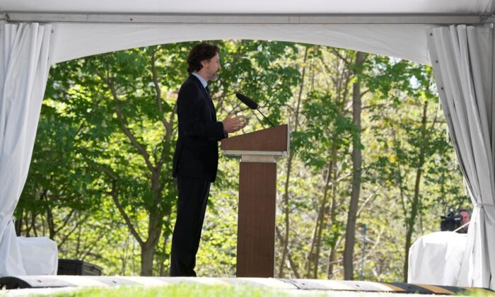 Prime Minister Justin Trudeau responds to a question from the media during a daily news conference outside Rideau Cottage in Ottawa, on May 22, 2020. (The Canadian Press/Adrian Wyld)