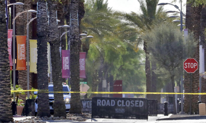 The Westgate retail district is closed off in Glendale, Ariz. on May 21, 2020. (AP Photo/Matt York)