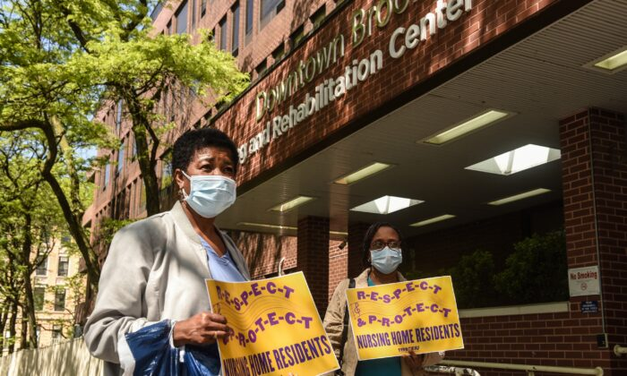 Nursing home workers hold a vigil outside of the Downtown Brooklyn Nursing and Rehabilitation Center in New York on May 21, 2020. (Stephanie Keith/Getty Images)