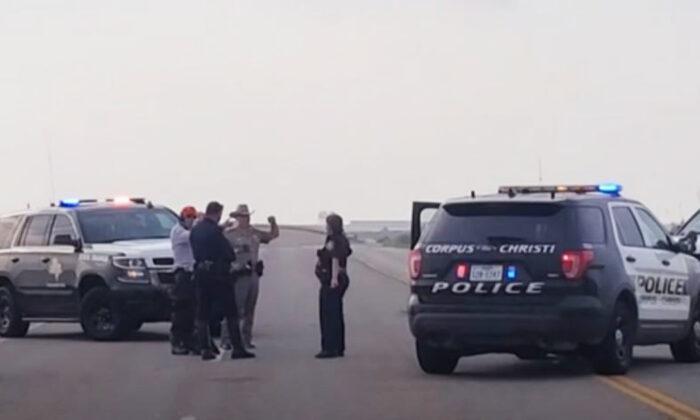 Police at naval air station in Tex. on May 21. (AP)