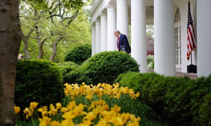 President Donald Trump arrives for the daily briefing on the Chinese Communist Party virus in the Rose Garden of the White House, in Washington, on April 14, 2020. (Mandel Ngan/AFP via Getty Images)