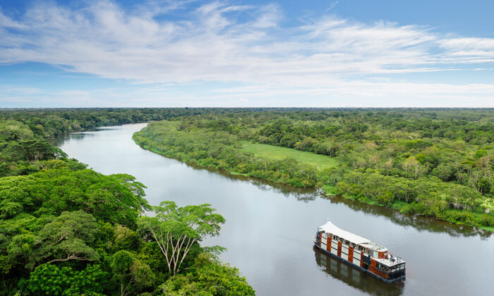 The Amazon river, like a highway cutting the through dense jungle, connects villages and towns. (Courtesy of Aqua Expeditions)