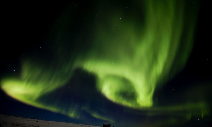 Aurora borealis, or northern lights, fill the sky on March 13, 2011 over Finnmark, northern Norway.   (Tore Meek/AFP via Getty Images)