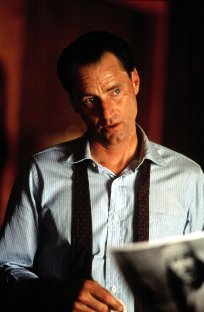 """FBI agent with untied tie in """"Thunderheart"""""""