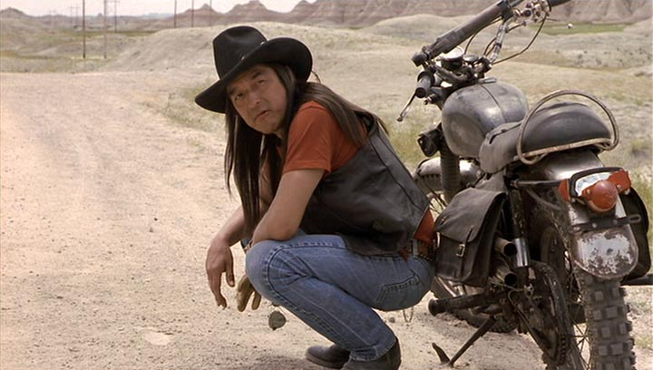 Native American with hat and motorcycle
