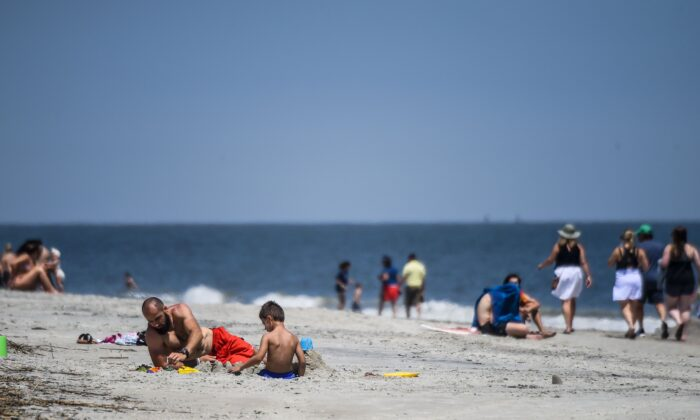 People relax on the Beach amid the CCP virus pandemic in Tybee Island, Ga., on April 25, 2020. (Chandan Khanna/AFP/Getty Images)