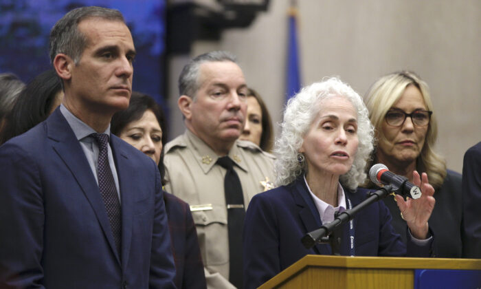 Los Angeles County Public Health Director Barbara Ferrer speaks at a news conference with Los Angeles Mayor Eric Garcetti (L) in Los Angeles on March 12, 2020. (Damian Dovarganes,File/AP Photo)