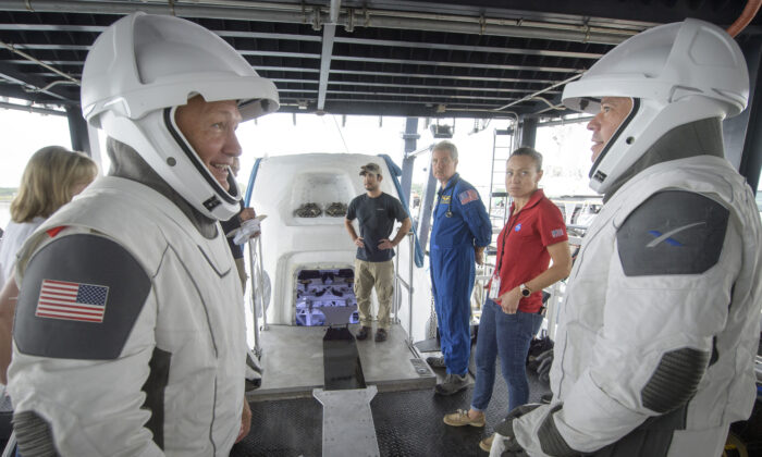 NASA astronauts Doug Hurley (L) and Bob Behnken work with teams from NASA and SpaceX to rehearse crew extraction from SpaceX's Crew Dragon, which will be used to carry humans to the International Space Station, at the Trident Basin in Cape Canaveral, Fla., on Aug. 13, 2019. (Bill Ingalls/NASA)