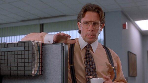 guy drinking coffee in an office