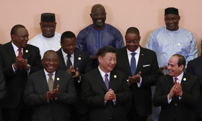 Chinese Communist Party leader Xi Jinping (front C), South African President Cyril Ramaphosa (front 3-L), Egyptian President Abdel Fattah al-Sisi (front L), Kenya's President Uhuru Kenyatta (2nd row L), Togo's President Faure Gnassingbé (2nd row C), Malawi's President Arthur Peter Mutharika (2nd row R), Sierra Leone President Julius Maada Bio (last row L), Liberian President George Weah (last row C) and other African leaders applaud during a group photo session during the Forum on China-Africa Cooperation (FOCAC) 2018 Beijing Summit on Sept. 3, 2018. (How Hwee Young /Pool/Getty Images)