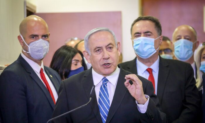 Israeli Prime Minister Benjamin Netanyahu delivers a statement before entering a courtroom at the district court of Jerusalem on May 24, 2020, during the first day of his corruption trial. (Yonathan Sindel/AFP via Getty Images)