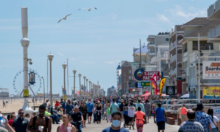 People enjoy the boardwalk during the Memorial Day holiday weekend amid the CCP virus pandemic  in Ocean City, Md., on May 23, 2020. (Alex Edelman/AFP via Getty Images)