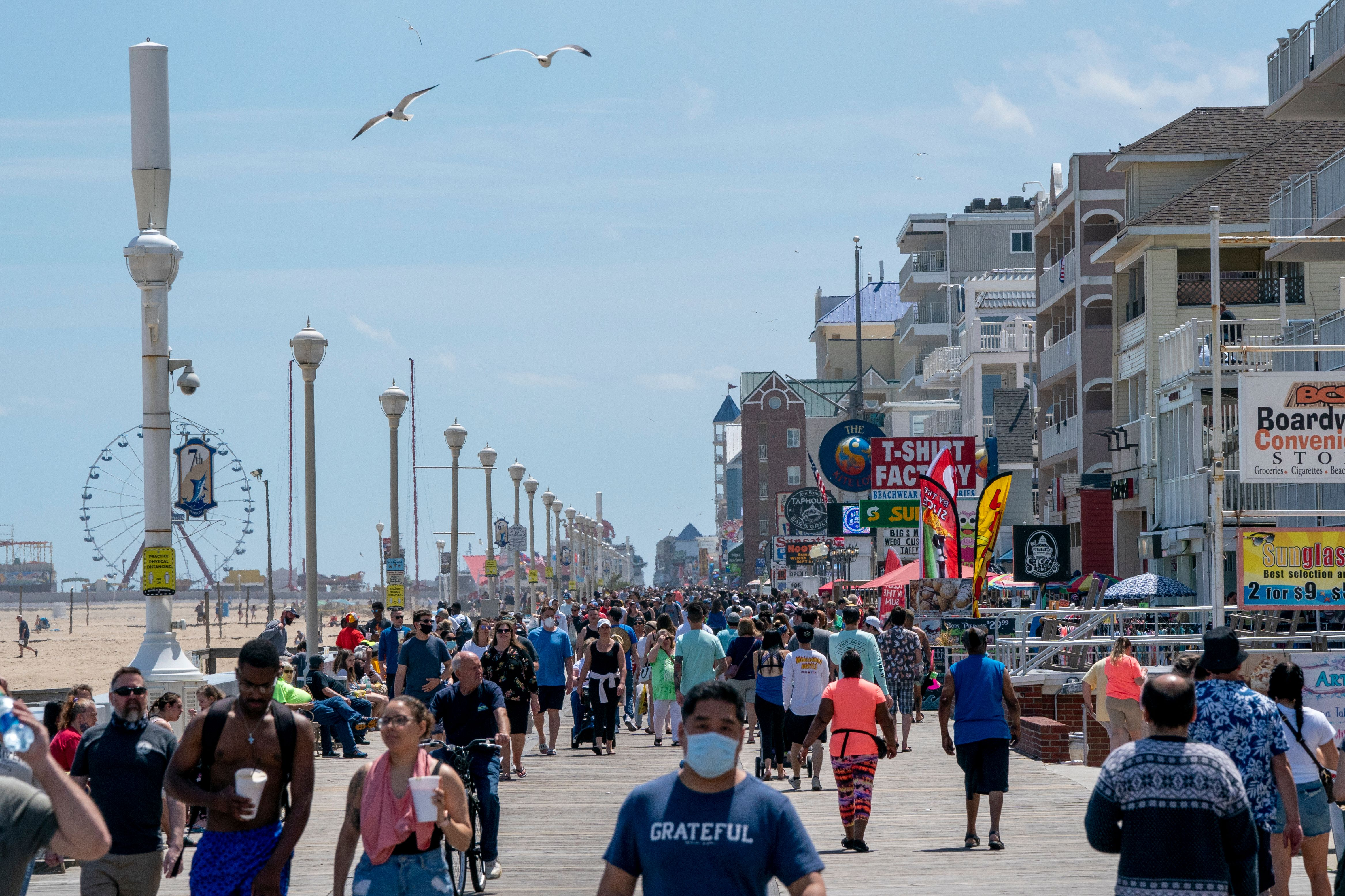 People enjoy the boardwalk during the Memorial Day holiday weekend