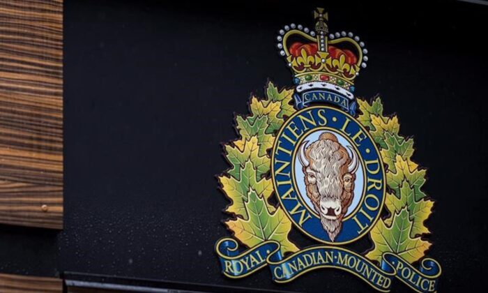 "The RCMP logo is seen outside Royal Canadian Mounted Police ""E"" Division Headquarters, in Surrey, B.C., on April 13, 2018. (Darryl Dyck/The Canadian Press)"