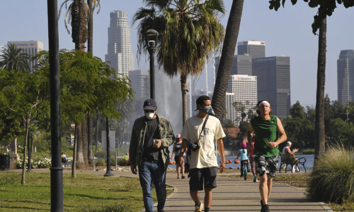 People utilize the Echo Park Lake recreation area in Los Angeles, Calif., on May 23, 2020. (Mark J. Terrill/AP Photo)
