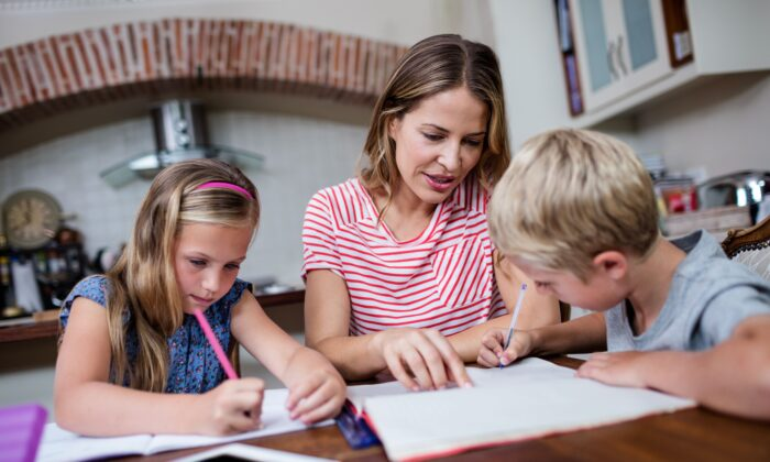 If K-12 classes remain online this fall, parents will be faced with the unreasonable burden of overseeing all of their kids' learning while at the same time trying to keep up with their regular jobs. (Wavebreakmedia/Shutterstock)