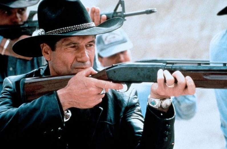 """man with black hat and rifle in """"Thunderheart"""""""