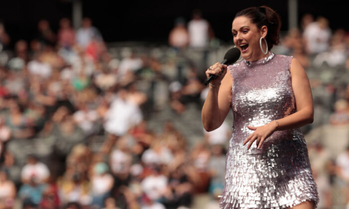 Comedian Celeste Barber addresses the crowd during Fire Fight Australia at ANZ Stadium on February 16, 2020 in Sydney, Australia. (Cole Bennetts/Getty Images)
