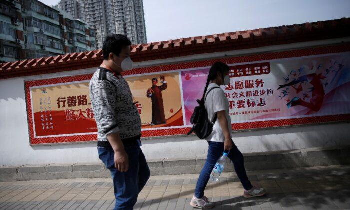Migrant worker Zhang Jianpeng, 28, and his wife Zhang Ruirui, 26, on May 13, 2020. (Tingshu Wang/ Reuters)