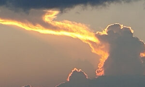 Unusual Cloud Looks Like a Huge 'Dragon' Breathing Fire Into the Sky