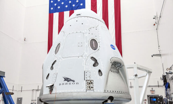 In April 2020, the Crew Dragon spacecraft undergoing final processing at Cape Canaveral Air Force Station, Fla,, in preparation for the May 27, 2020, Demo-2 launch with NASA astronauts Bob Behnken and Doug Hurley to the International Space Station for NASA's Commercial Crew Program. (SpaceX via AP)