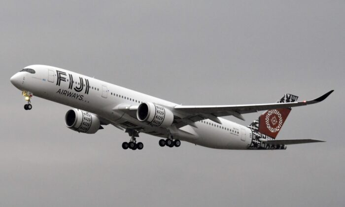 A new Airbus XWB A350-900 of Fiji Airways takes off for its first flight at the Airbus delivery center, in Colomiers, near Toulouse, southwestern France, on Nov. 15, 2019. (Pascal Pavani /AFP via Getty Images)